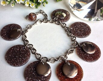 Bracelet fancy round charm in silver sequined resin, vintage, but new, English jewelry