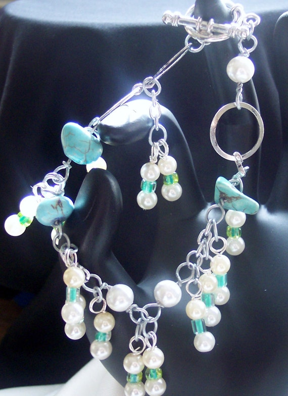 A style of your own! Teal blue rocks, pearls and clear green spacers, circle links and pearl danglers.