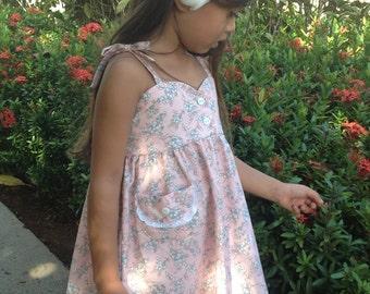 Girls Bodice Dress with Adjustable Shoulder Tie Straps and a Lace Trimmed Pocket, pink floral print, Infant and Toddler
