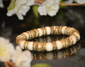 Ivory and gold effect stretch bracelet