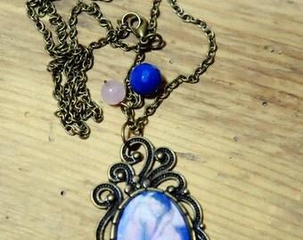Saltire Bohemian bronze color, Medallion motif Nu fetus, creating unique necklace