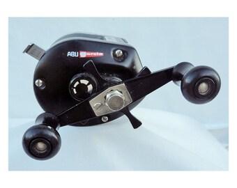 Items similar to old abu garcia ambassadeur eon e3600 for Push button fishing reel