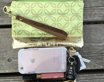 Wristlet with detachable leather strap