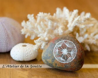 Painted pebble - The dandelion flower
