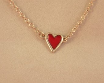 Two in one. Sterling silver double sided heart necklace on 2.5mm rolo chain with s.s. lobster claw