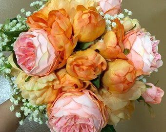 Wedding bouquet,peach color peony ,pink rose ,and babybreath.