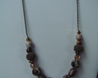 Brown beaded necklace with gunmetal chain