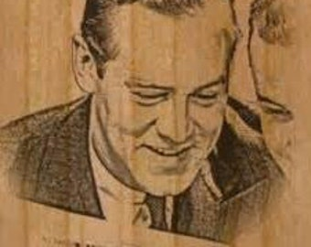Custom photo engraved wood phone cover.
