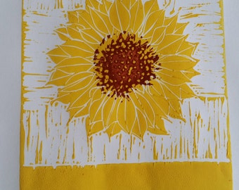 Linocut of sunflower in two colours
