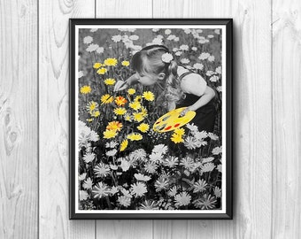Little girl paints the color yellow daisies