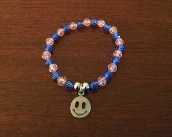 Handmade Costume Jewelry Bracelet w/Smiley Face Charm, Pink and Blue Beads & elastic so it fits most wrists.