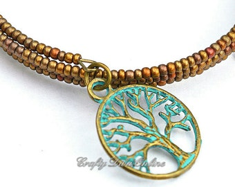 Satin Bronze Beaded Bracelet with a Green Patina Tree of Life Charm