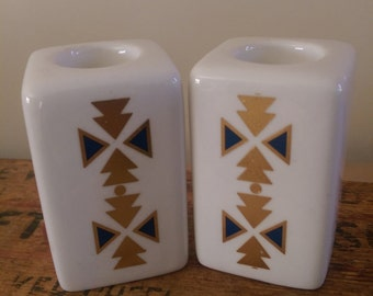 Pair of ceramic candle holders with elegant silvertriangle  decal