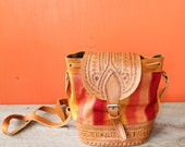 vintage tooled leather bucket bag with woven fabric, drawstring and crossbody strap . 1990s souvenir Nicaragua purse 90s