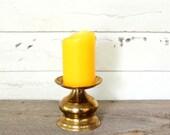 vintage brass pedestal candle holder . wide candle base, brass candleholder