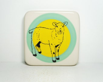 tile featuring a sheep, on a colour block of blue green and yellow. Made to Order.