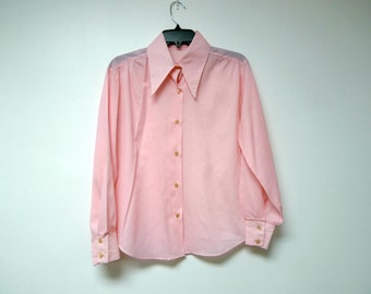 "SALE!!!   Pink . 60s 70s button down . long sleeves . poly shirt . fits a medium to large . 42"" bust"