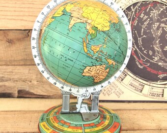 Metal globe Atlas Ohio Art Kermit Bishop, cartographer  c1932. tin