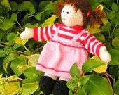 Brunette hand-knitted dress-up doll with gorgeous hand-knitted clothes