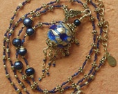 Vintage Japanese cobalt blue, sterling silver foil Lava glass pendant and hand knotted Bali beaded necklace