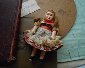 antique celluloid doll in lacey european dress  handmade crocheted or tatted dress