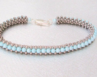 pale blue beaded bracelet silver bangle