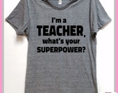I'm a TEACHER, what's your SUPERPOWER? UNISEX.Grey Heather tri blend super soft t- shirt. Great teacher gift! Education. Super hero. teach