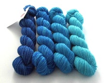 Hand dyed yarn -  gradient blue superfine merino sock weight yarn, fingering, 4-ply. Semi-solid blue ombre. Limited edition soft merino wool