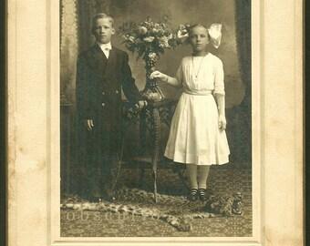 Confirmation Girl & Boy on Leopard Skin Rug - Wausau, WI - Antique Cabinet Photo