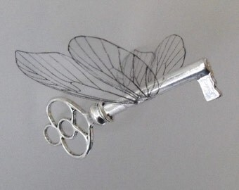 Flying key with small reversed butterfly wings in shiny silver - SSHTSBFR