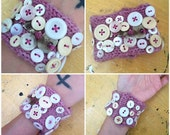 hand-knitted cuff bracelet covered in vintage buttons and a metal key .... made by Vivid Vivka