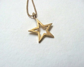 Little gold star cutout charm necklace on 14k gold plated chain