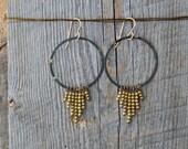 LITZA. Golden beaded brass patina hoops