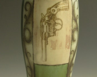 Wood soda fired tumbler/vase with revolver and scrolls