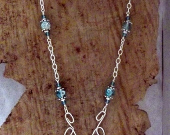 Blue Semi Precious Stone Pendent Dangling from Wirework