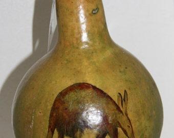 gourd birdhouse with ant eater, aardvark