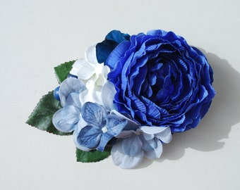 Beautiful royal blue ranunculus with blue and white hydrangeas,blue rhododendron and blue berries bridal hair flower pin up wedding vintage