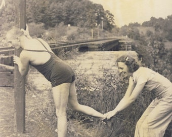 You Have To STRETCH THOSE LEGS Before You Exercise In Fun Photo Circa 1920s