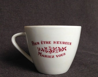To be happy, get married it says... Vintage festive engagement cup.