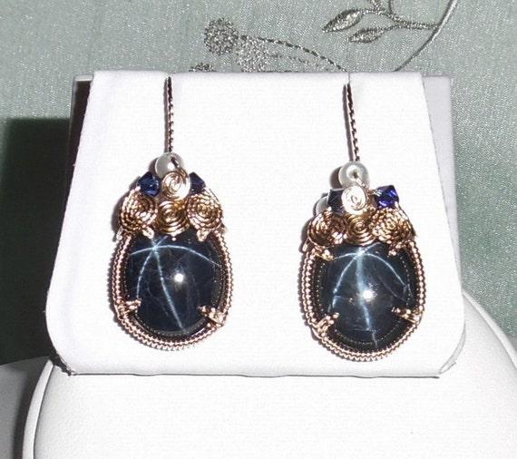 43 cts Natural Deep Blue 6 Star Sapphire gemstones, 14kt yellow gold Pierced Earrings