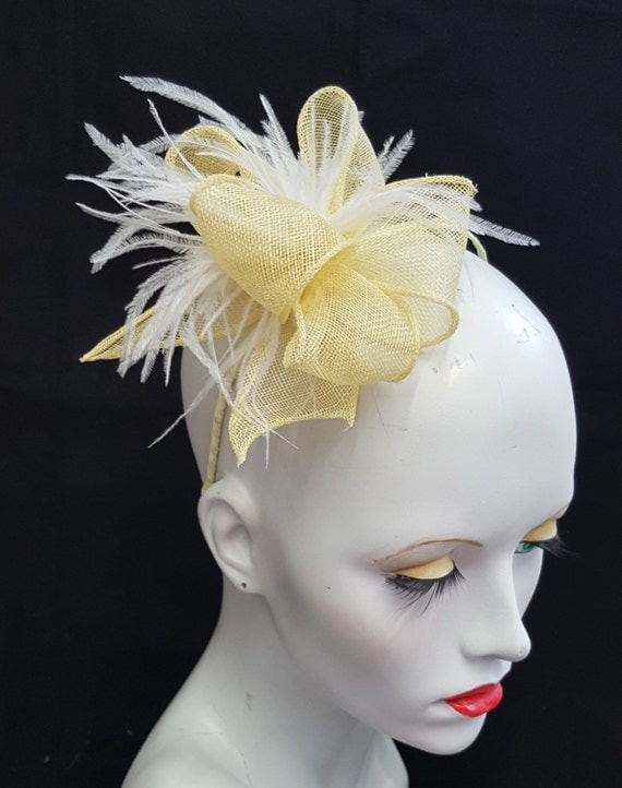 pale lemon yellow sinamay fascinator with white feathers