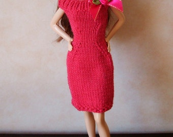 "Handmade 11.5"" Fashion Doll Clothes. Raspberry pink knitted dress with bow trim."