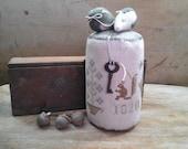 primitive cross stitch Lidya Corker pinkeep drum and strawberry pinkeep Squirrel 1820 needfuls