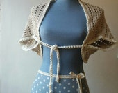 Bohemian hand crocheted bolero shrug or shawl in neutral grey and white cotton yarn.