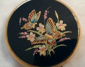 Stratton Powder Compact Featuring Two Butterflies On A Floral Motif All On A Blue Enamel Background circa 1970's   DR239