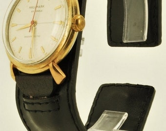 Hallmark vintage wrist watch, 25 Jewels, water resistant yellow gold filled & stainless steel case, champagne-toned metal dial, leather band