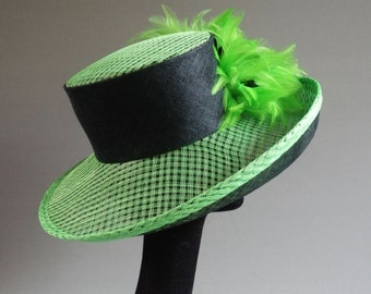 Dutch design sinamay hat in black and green with ton sur ton feathers size 58 or 22.8 inch