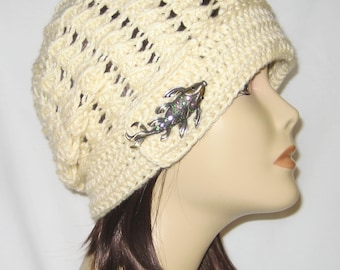 """Slouch decorated with brooch,beanie,hat,cap,cream colored,made to fit most teens & adults 21-23"""""""