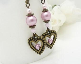 Dusty rose pink pearl earrings, Beaded jewelry, Vintage style antique bronze heart earrings, long pale pink pearl dangle earrings