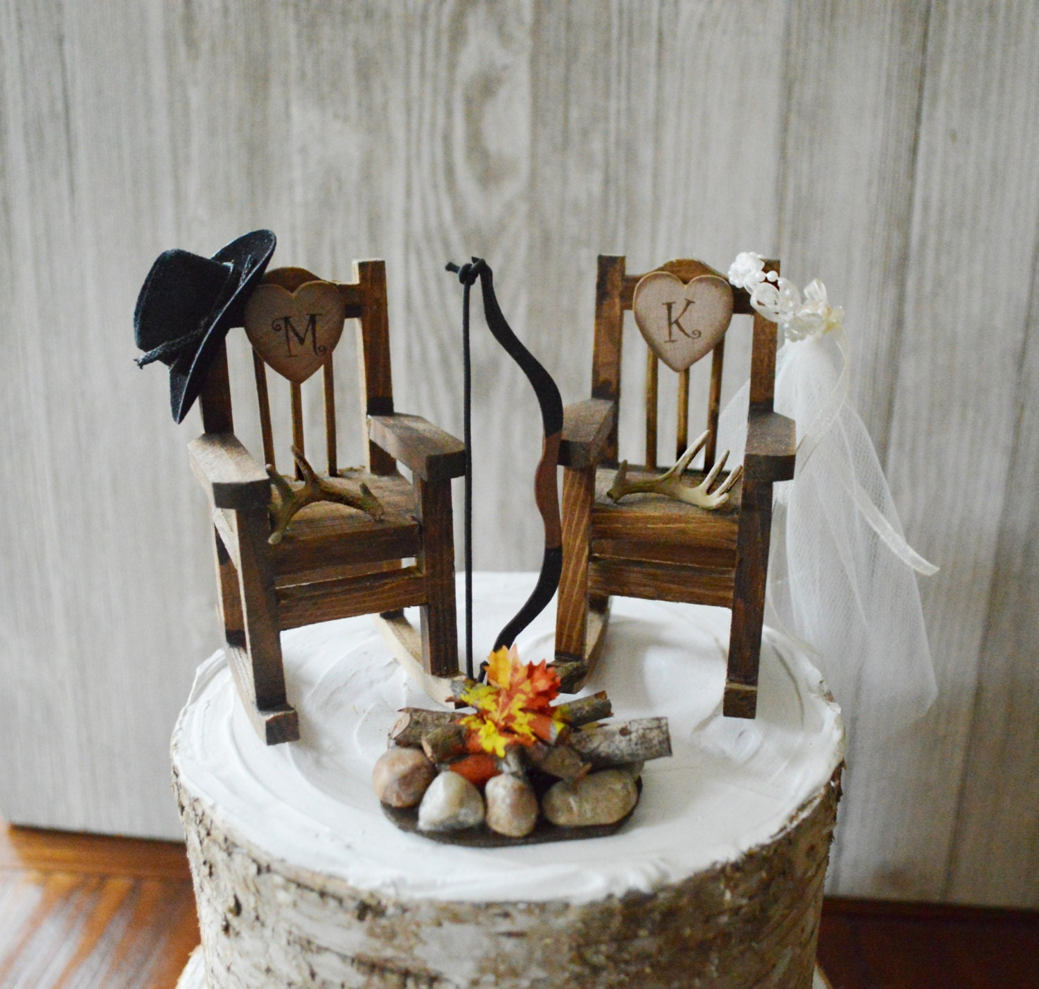 wood rocking chair hunting bow and arrow wedding cake topper